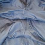 Reparatie van de gaten in de jas